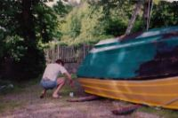 GH14 was 14' fiberglass open boat, simple, but well-designed, stable and versatile. It ran fast with a 15HP outboard engine.