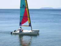 Hobie Cat 13' Wave was slightly smaller than the more common 14' cat. It was very easy to sail, however I rate the 14 footer superior.