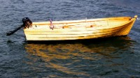 I bought this 15' rowing boat from a builder in Tustna, North-west Norway. It's a bit wide for rowing and use it with a 6HP long-stem Tohatsu outboard.