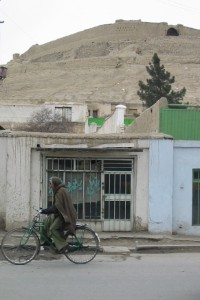 Biking in front of Kabul's old citadel (February 2002).