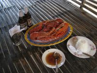 Fresh seafood grilled on the beach.