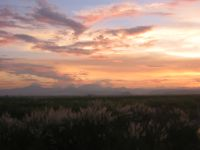 The sun sets behind the Zambales mountains as seen from Tarlac, Central Luzon.